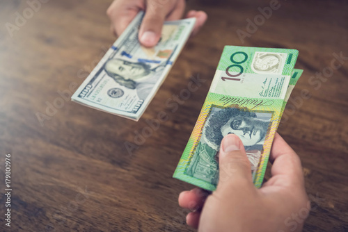 Exchanging US dollars and Autralian dollars Wallpaper Mural