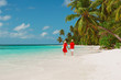 happy loving couple walk on beach
