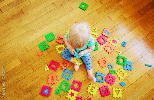 Fotografie, Tablou  little toddler girl learning numbers, education concept