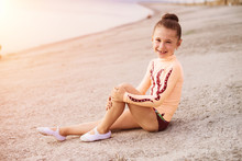 Flexible Little Girl Gymnast Outdoor. Sport, Training, Fitness, Yoga, Active Lifestyle Concept