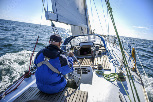 Voile Skagen, Denmark, 31 July 2017: A lone sailor behind the helm on the North Sea