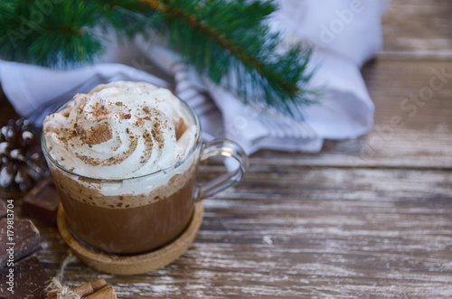 Spoed Foto op Canvas Chocolade Cup of hot chocolate cocoa with whipped cream and chocolate crumbs on wooden table with christmas decoration. Delicious cold weather beverage concept.Copy space