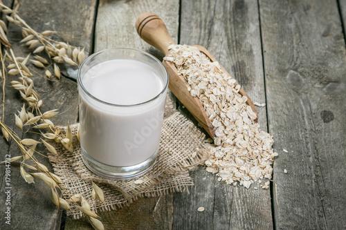 Fotografie, Tablou  Oat milk alternative on rustic wood background