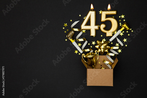 Photographie  Number 45 gold celebration candle and gift box background