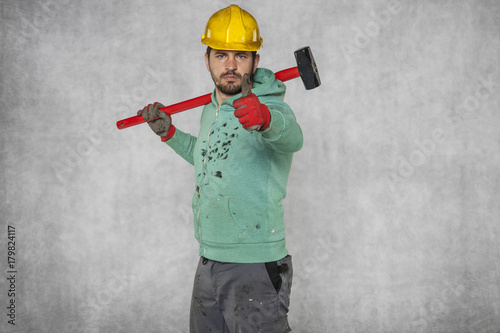 Fotografie, Obraz  happy worker with a hammer on his shoulder