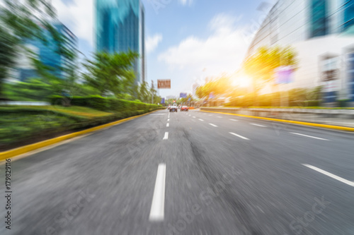 blurry empty asphalt road and modern buildings in shanghai Poster
