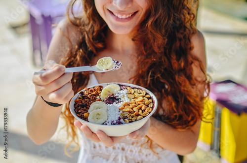 Acai bowl woman eating morning breakfast at cafe Canvas Print