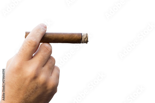 Fotografia  Detail of the hand of a smoking man holding a burning cigar, isolated