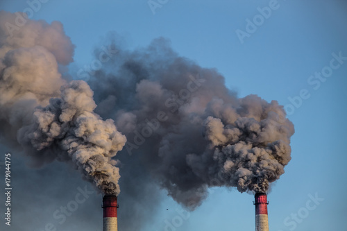 Fotobehang Rook industrial chimneys with heavy smoke causing pollution