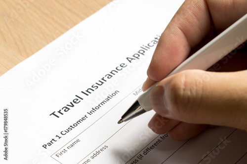 Photo Man wait to fill information in travel insurance application form on desk backgr