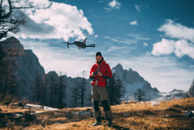 Nature  Photographer Flying A Drone In Mountains, Julian Alps, In Europe.