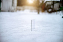 Ruler Measuring The Snow Thickness. Toning