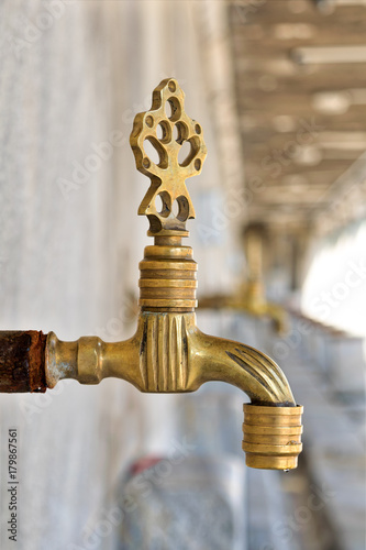 Fotografia, Obraz  Turkish Ottoman style antique ablution tap with blurred background, Istanbul, Tu