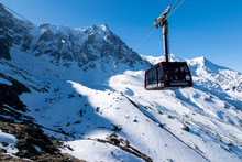 A Cable Car Heads To Aiguille Du Midi In The Alps (Chamonix, France)