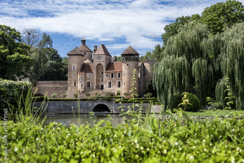 Foto auf Leinwand Schloss France, Department Saone-et-Loire, Sercy: Front view of an old castle (chateau) surrounded by park and water