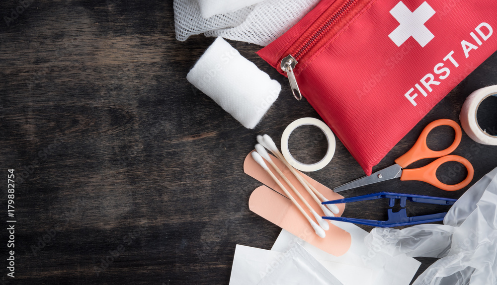 Fototapeta First aid medical kit on wood background,copy space,top view
