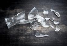 Broken Bottle Glass On Wooden Floor