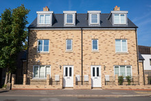 Newly Built Three Floors Semi Detached Houses On An Empty Street In England, UK