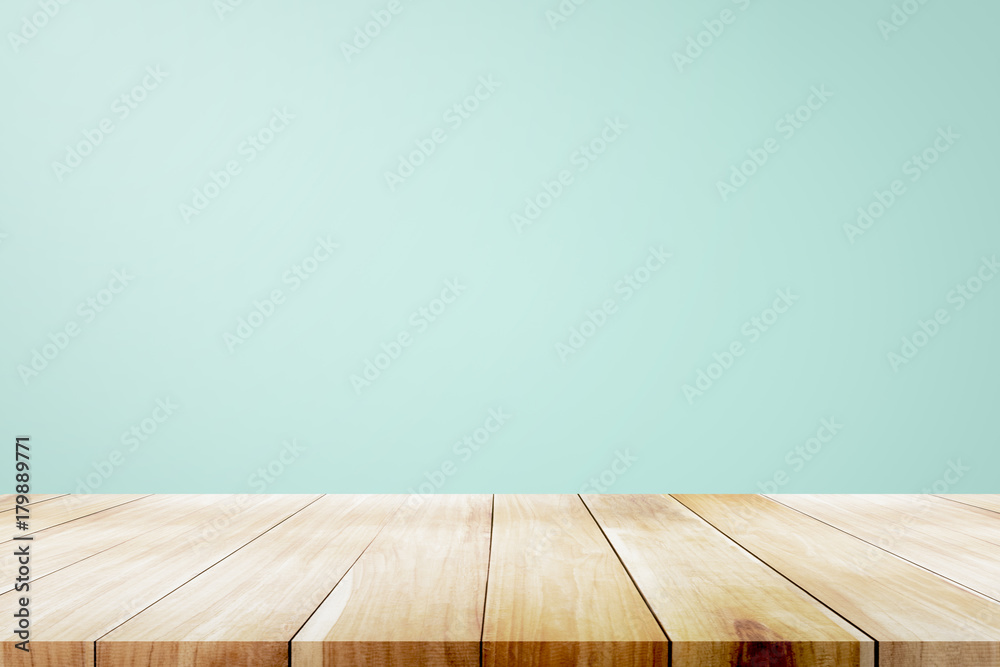 Fototapety, obrazy: Empty wooden deck table over mint wallpaper background.