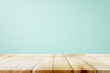 canvas print picture - Empty wooden deck table over mint wallpaper background.