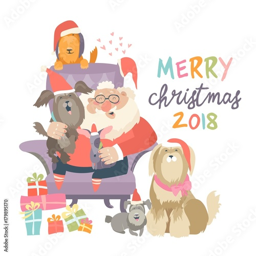 Santa Claus sitting in armchair wih dogs