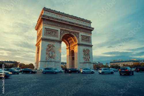 Fotografía Famous Paris avenue Champs-Elysees and the Triumphal Arch, symbol of the glory on bright sunny day with cloudy sky