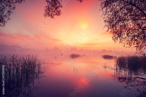Tuinposter Crimson Early morning, dawn over the lake. Misty morning, rural landscape, wilderness, mystical feeling