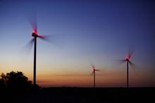 Wind Power Generation, Wind Turbines On Farmland At Night