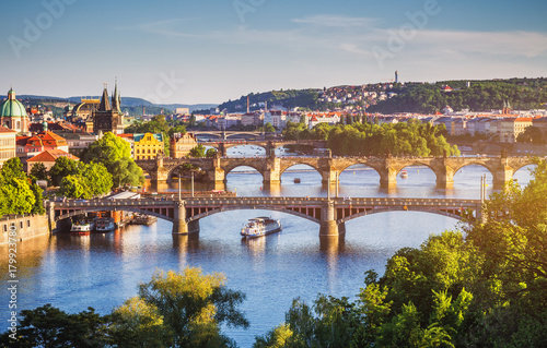 Charles Bridge (Karluv Most) and Lesser Town Tower, Prague in summer at sunset, Czech Republic