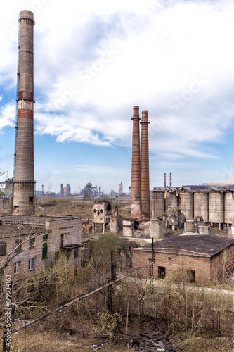 industrial landscape destroyed and abandoned shops of cement and