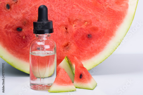 concentrate of watermelon flavor in a bottle, next to it