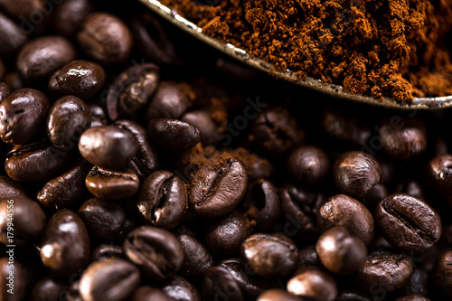Photo  Coffee poured into an ancient antique silverware spoon