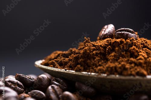 Fototapeta Coffee poured into an ancient antique silverware spoon