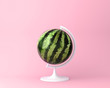 Leinwanddruck Bild - Globe sphere orb watermelon concept on pastel pink background. minimal idea food and fruit concept. An idea creative to produce work within an advertising marketing communications or artwork design.