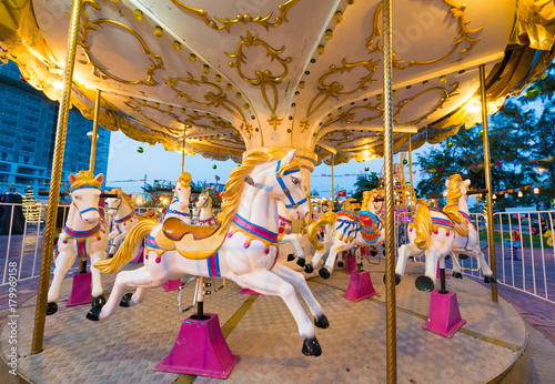 Fotografie, Tablou  merry go round horses with nobody, wide lens