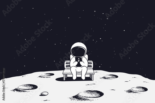 astronaut sits on the bench and see to mobile phone Fototapeta