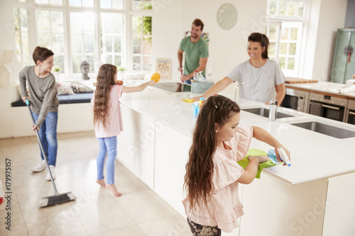 Children Helping Parents With Household Chores In Kitchen Canvas Print