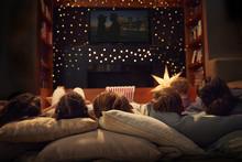 Family Enjoying Movie Night At...