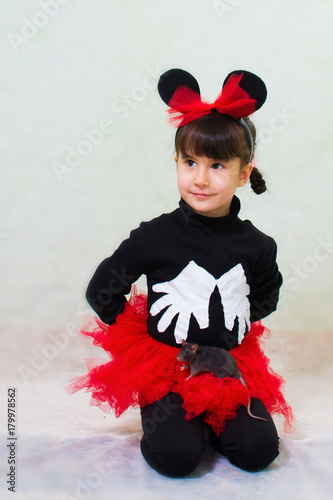cute little girl in a bear costume with ears holds a hand rat Poster