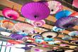 Leinwanddruck Bild - A traditional Japanese umbrella / Hung upside down Japan colorful umbrella and decorated