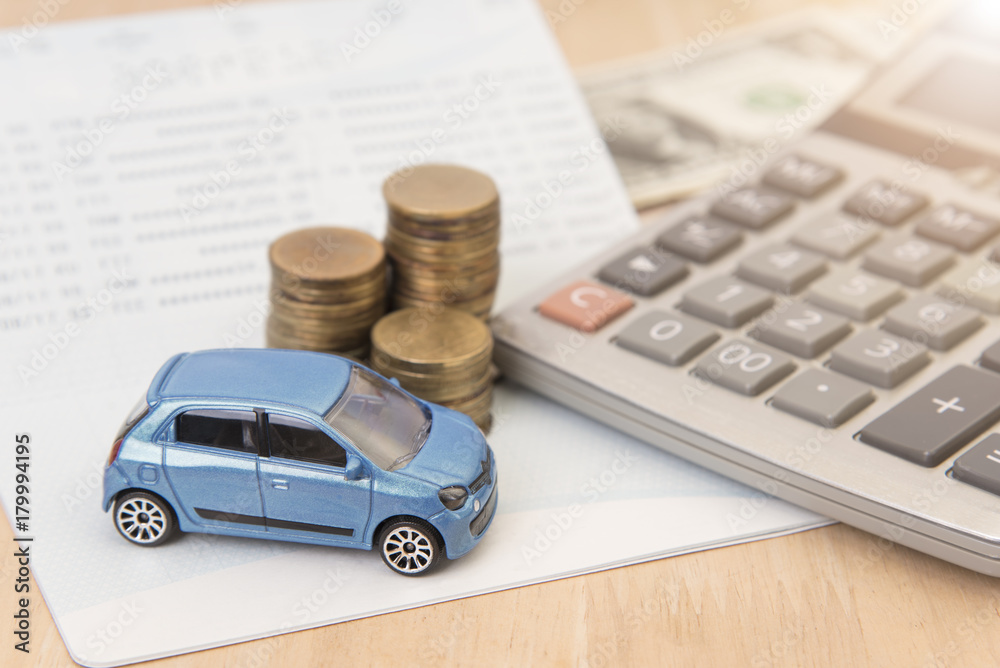 Fototapety, obrazy: car with calculator and money on wood table. insurance concept.