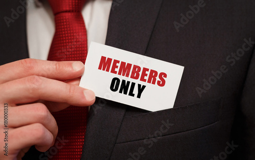 Photographie  Businessman putting a card with text MEMBERS ONLY in the pocket