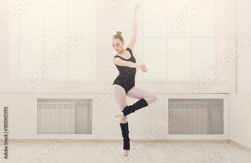 Fotografija Beautiful ballerina stands in ballet pirouette