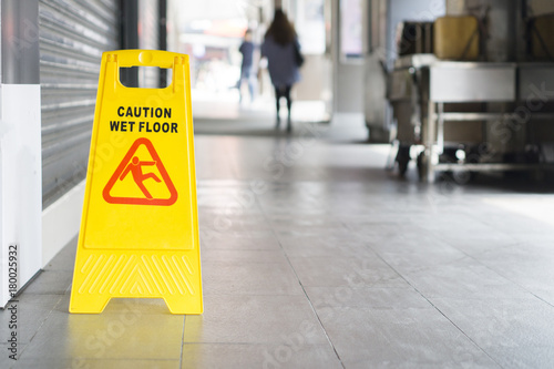 yellow sign inside building hallway showing warning of caution wet floor,selective focus,vintage color Fototapet