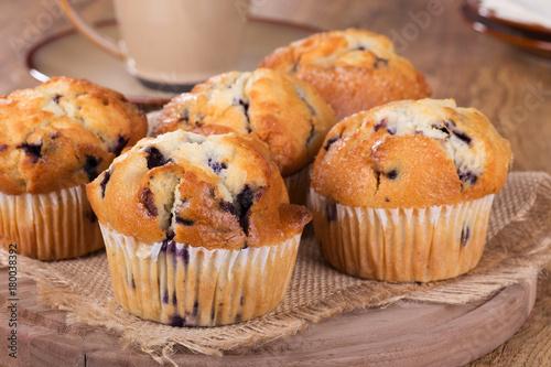 Fotografie, Obraz  Golden Brown Blueberry Muffins on a Wooden Platter