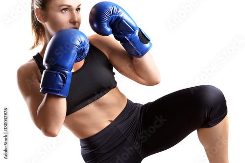 Cuadros en Lienzo Female kickboxer on light background