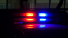 Flashing Lights Of The Police Car At Night