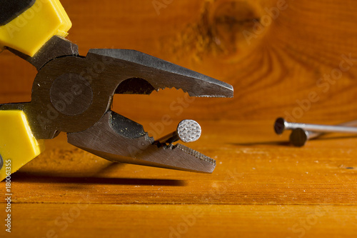 Photo Flat nose pliers with nail