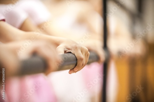Photo  Closeup of Young Ballet Dancers Holding a Ballet Barre