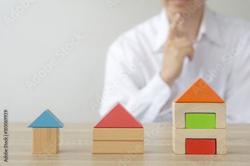 Fototapeta man making  decision to choose the house obraz
